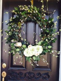 Front door spring 'bling'.  DIY Grapevine wreath, greenery, tiny floral whimsical flowers, few larger flowers and a precious bird.