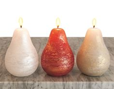 Brushed with pearl and #gold, these #pear candles create a #holiday atmosphere! Hand poured, unscented, food grade wax; smokeless and dripless. 40 hour burn time!  https://www.menusandmusic.com/Holiday_Pear_Candles_p/16h-1102.htm  #MenusAndMusic