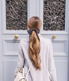 Beautiful Long Ponytail Fastened With A Big Black Bow