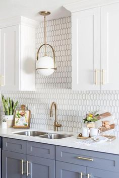 kitchen backsplash with gold fixtures and grey cabinets #bestkitcheninterior