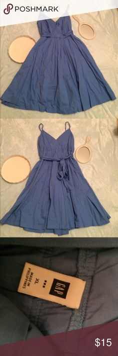 """Gap dress size XL Gap sun dress size XL. In good used condition. Blue in color. Ties around the back. 100% cotton. The straps can be taken up. Has some elastic in waist area. 20"""" armpit to armpit, 18"""" waist, full length 40"""". Comes from smoke free and pet free home. GAP Dresses"""