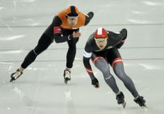 DAY 9:  Mark Tuitert of the Netherlands and Haralds Silovs of Latvia compete during the Speed Skating Men's 1500m http://sports.yahoo.com/olympics