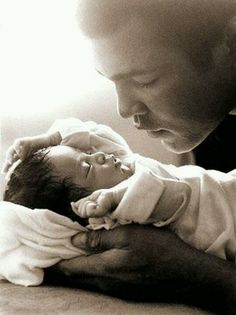 Muhammad Ali with his baby daughter, Laila Ali in Such a beautiful and precious photo. (Photo by Michael Gaffney),