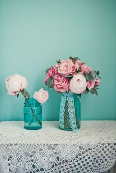 Our centerpieces - vintage Ball jars as vases.