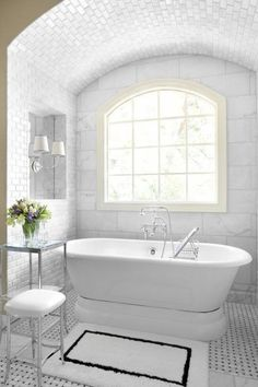 Beautiful… marble tile on the walls, basketweave tiles on the floor, and subway tiles on the arched ceiling (via Ansley Park Master Ba...