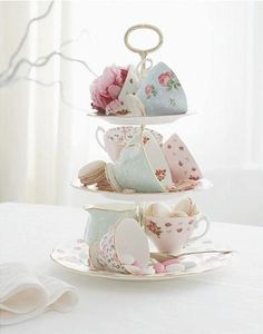 tier of teacups - love those pretty shabby chic english style displays~