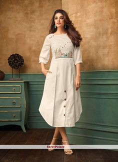 Latest indian party wear kurti for women. Shop online in india, uk, usa, canada. Grab this cotton satin thread work work party wear kurti. Kurta Designs Women, Kurti Neck Designs, Design Of Kurti, Latest Kurti Designs, Frock Style Kurti, Fancy Kurti, Kurti Styles, White Embroidered Dress, Kurti Designs Party Wear