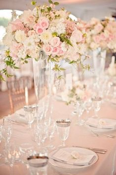 Pantone's rose quartz looks perfect in these tall glass vases and mixed with white and small pops of green.