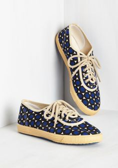 Sporty Favors the Bold Sneaker in Dots. Score the winning point for your slam-dunk outfit by lacing into these printed sneakers from Startas! #blue #modcloth