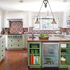 Patterned tile backsplash, colored lower cabinets, white upper ones.