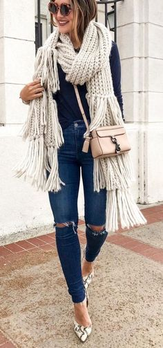 Carry ripped jeans into winter by adding a chunky knit scarf to your outfit. Top it off with heels for an elegant twist. Let DailyDressMe help you find the perfect outfit for whatever the weather!