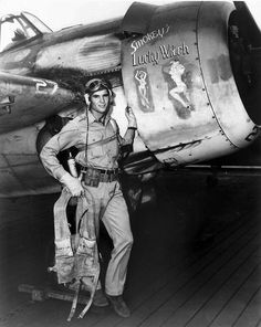 Ensign Darrell Bennett beside his FM-2 Wildcat 'Smokey's Lucky Witch', USS Gambier Bay, 1 Aug 1944