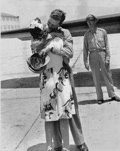Robert Morgan, pilot of the bomber Memphis Belle; kissing his Memphis Belle.