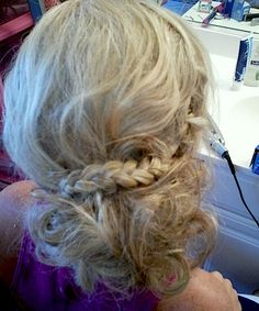 Prom hairstyle. First, curl all hair and then tease, braid the bangs back and then pin curls up. :)