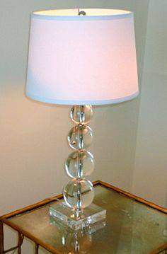 Staging tip: Glass lamp bases visually take up less space than lamps with solid bases. Available in every price point, they take up little space and work well on end tables, consoles, desks, and night stands. Glass Lamp Base, Night Stands, Price Point, Chandelier Lamp, Furniture Arrangement, Floor Lamps, Lamp Bases, Glass Table, Home Staging