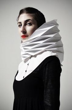 (Veasyble by Gaia) the geometric nature of the neck on this piece contrasts well with the black, regular cloth shirt.