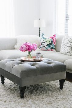 "Erin Sousa's decor picks and tips: ""This custom piece brings such a softness to our living space. We love how it juxtaposes with our more modern couch and chose a darker grey fabric for practicality purposes and top it with a tray to act as a place to display flowers, and put our drinks.""    Lolita Ottoman in Elephant from Lofty Living Lifestyle"