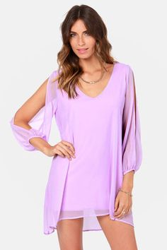 Check it out from Lulus.com! When it's time to shift your gears into glamor mode, the Shifting Dears Lavender Long Sleeve Dress is our most dearly beloved dress! Lavender Georgette forms a roomy shift silhouette with a deep, scoop neckline and a flared shape that flows into an asymmetrical, concave hemline. Long, sheer sleeves have on-trend, cold shoulder cutouts that open all the way to the cuffs. Dress is lined. Model is wearing a size small. Dress measures 3