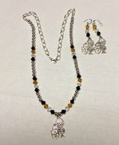 Sir saint necklace and earrings