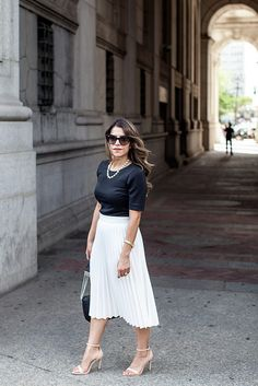 Pleated White Skirt black crop top express top jcrew necklace nude heels fashion blogger corporate fashion blogger nyc blogger foley+corrina handbag black bag chanel inspired simple outfits black and white outfits white pleated skirt prada cat eyed sunglasses