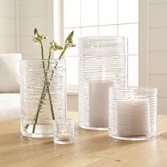 Shop Spin Glass Hurricane Candle Holders/Vases.  Spun glass cylinders with distinctive organic texture create a dramatic candlelight glow or showcase for fresh flowers. You don't need to be a florist to arrange flowers like one.