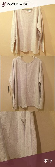 Long Sleeve Top w/ Mesh Cutouts *NEW W/ TAGS* This shirt is brand new with tags. It's heather grey with mesh stripes in the back and down the arms starting at the shoulder. Old Navy Tops Tees - Long Sleeve
