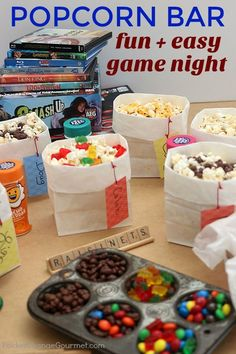 sleepover night POPCORN BAR -- Kids of ALL ages will love this easy to serve Popcorn Bar! Grab the games - its time for GAME NIGHT! Flavored salts and Candy in a variety of flavors! Game Night Parties, Movie Night Party, Slumber Parties, Girls Night In Games, Indoor Movie Night, Game Night Snacks, Night Games, Slumber Party Games, Mouse Parties