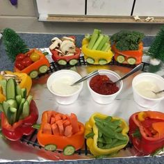 Veggie train! Actually doesn't look too difficult or time consuming to make. Great for kids' parties!