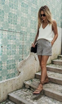For a casual, effortless look rock your striped shorts with a wide white top and sandals.