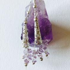 Made a pair of amethyst silver wire crochet earrings with silver beads!