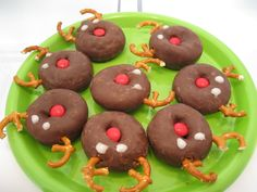 A craft you can eat! We made these awesome reindeer (caribou) for a children's program right before Christmas. The treats give you a great opportunity to talk to your kids about the amazing deer family of deer, moose, elk and reindeer!     Face-chocolate doughnut   Nose-red MandM Eyes- Frosting (powdered sugar and corn syrup)  Antlers- Pretzels
