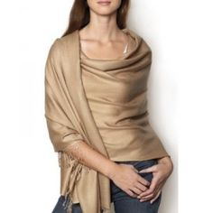 Pashmina - the ultimate travel accessory. Use it on a plane for a pillow or a blanket and of course as a gorgeous wrap on cool summer nights. We think it looks stunning in luxurious gold!