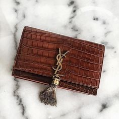 We adore this Vintage YSL #designer handbag - the tassel works perfectly with our Blenheim Collection! - Shop at Stylizio for luxury designer handbags, leather purses and wallets. Women's and Men's watches, jewelry, sunglasses and other accessories. Fine gold and 925 sterling silver rings, necklaces, earrings. Gift ideas for women and men!