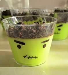 Green vanilla pudding with oreo crumbs | placed in a cup with a Sharpie-drawn monster face on the outside...