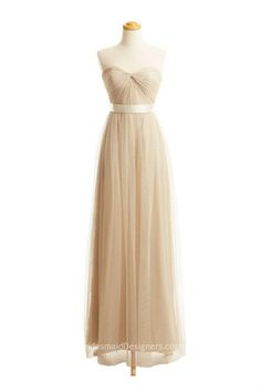 Champagne long tulle bridesmaid dress features sweetheart neckline, strapless bodice features pleats,   sheer ribbon is attached at back, zipper closure.