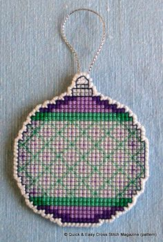 This pattern from Quick & Easy Magazine was perfect for creating a hangable Christmas tree decoration in a variety of colours. I made this one in cross stitch on a 14ct plastic canvas square using whatever stranded cotton threads I had that I thought look good together. Then I cut very carefully around the bauble leaving one line of canvas intact all round, which I oversewed in white perle.
