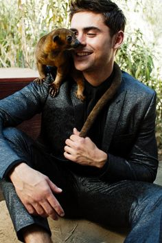 Zac Efron Suits Up, Cuddles With Animals For 'BlackBook' Magazine
