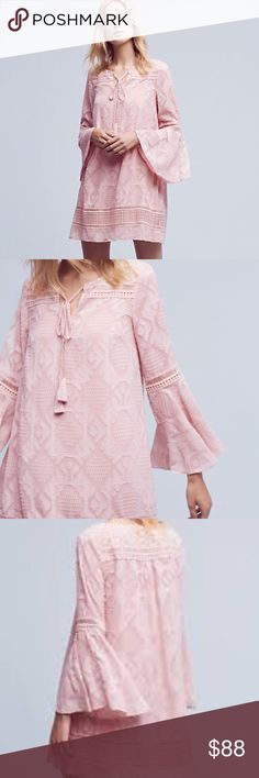 Anthropologie Floreat Esme Bell-Sleeve Dress This light and airy dress is exactly what you need this summer! The light pink color and intricate detailing make this dress extra sweet. In great condition. Tassel ties hang from the front neckline. *this dress is not lined, so you will need to wear a slip underneath. Otherwise it is see-through. There are little snaps inside by the shoulders to hold the straps of a slip in place!* Anthropologie Dresses Mini