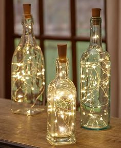 Give new life to your empty wine bottles with a Set of 3 Wine Bottle Stopper String Lights. These lights transform any bottle into a romantic mood light, w # diy wedding decorations Sets of 3 Wine Bottle Stopper String Lights Wine Bottle Stoppers, Wine Bottle Crafts, Wine Bottle Corks, Wine Decanter, Alcohol Bottle Crafts, Empty Wine Bottles, Lights In Bottles, Lighted Wine Bottles, Wine Bottle With Lights