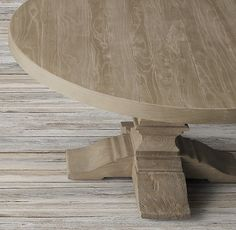 RH's Dumont Round Dining Table:Drawing inspiration from 18th-century Europe, our elm table features exquisite, hand-carved supports. To achieve the beautifully weathered character of an antique, skilled artisans employ a painstaking, multistep finishing process.