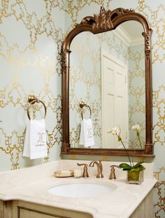 Kara Cox Interiors: Gorgeous powder room with blue & gold lattice wallpaper, ornate mirror, wire brushed oak ...