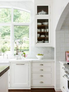 large pane arch window + dark walnut wood interior cabinet + marble detail + glossy white tile in classic kitchen design Kitchen Countertop Options, White Kitchen Cabinets, Glass Cabinets, Inset Cabinets, Shaker Cabinets, Countertop Materials, Glass Shelves, Pine Shelves, Antique Cabinets