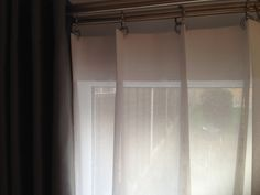 Full Length Eyelet Curtains With Contrast Band To The Bottom Edge On A Double Nickel Rail