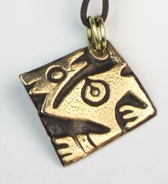 "Unique, one-of-a-kind necklace with ancient Inca mythical animal design. Ancient Shamanistic charms were discovered in archeological sites of Peru.    Made of kiln-fired bronze.  Optional 20 inch round, braided leather cord necklace with a Sterling Silver lobster clasp, is available.  Or, optional 22 inch bronze patina metal ball chain.  Please see choices above.    Pendant is 1.25"" square.  Please see optional choices above.    See other ancient symbolic pendants in my other shops.    Free…"