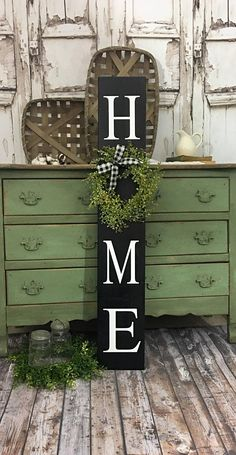 Vertical Home Sign with Wreath. Tall Porch sign. Home Porch Sign Brown welcome sign. Welcome sign. Vertical Home Sign. Black. White. Adorable Home porch sign with a baby grass wreath- perfect sign to welcome your guests to your home! Background color is a Chocolatey Brown paint with