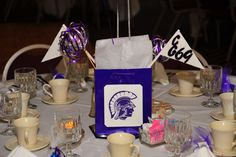 Take a gift bag, and glue on a picture of the school mascot. Attach balloons. Cute!
