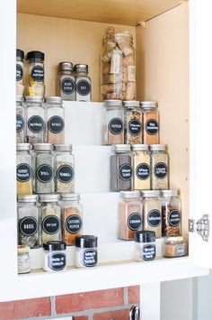 The Best DIY Hack for Organizing Spices in a Cabinet - Joyful Derivatives - - Never struggle to find the right spice again. This DIY Tiered Spice Rack makes organizing spices in a cabinet easy and super efficient! Cabinet Spice Rack, Diy Spice Rack, Spice Storage, Kitchen Spice Racks, Spice Jars, Spice Rack Organization, Kitchen Organization Pantry, Craft Organization, Cool Diy
