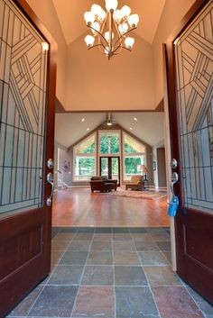 The vaulted ceiling of this luxury foyer draws attention inward, foreshadowing the vaulted ceiling of the enormous living space beyond.