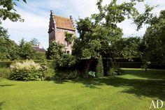 Traditional Exterior by Axel Vervoordt in Belgium