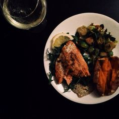 salmon over baby Arugula, Lemon and garlic roasted Brussels sprout, with a baked sweet potato.  with a chèvre and fig jam dressing